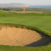 A view of hole #9 with bunker in foreground at Freshwater Bay Golf Club