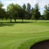 A view of a green guarded by bunker at Woolton Golf Club