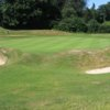 A view of a green guarded by sand traps at Royal Norwich Golf Club