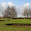 A view of  a green guarded by bunkers at Fosseway Golf Club