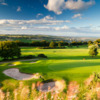 A sunny view of a green protected by bunkers at Hallamshire Golf Club