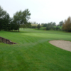 A view of a green protected by bunker at Roundwood Golf Club