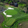 Aerial view of the 12th green protected by bunkers at Tidewater Golf Club