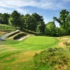 A view of the 6th green with narrow path on the left side at Hindhead Golf Club