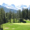 View of a green with mountains in the back at Crowsnest Pass Golf and Country Club