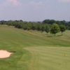A view of a green protected by bunkers at Erlestoke Golf Club