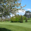 A view of a fairway guarded by spring blossom trees at Droitwich Golf & Country Club