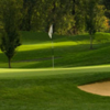 A view of a green protected by bunker at Kamloops Golf and Country Club