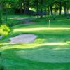 A view of a green guarded by bunkers at Brookside Country Club