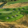 A view of green #13 protected by a collection of bunkers at Harmony Golf Club