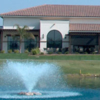 A view from Seal Beach Navy Golf Course with a water fountain in the foreground