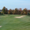 A view of a green guarded by sand traps at Timber Wolf Golf Club
