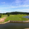 A view over the water of green #18 at Scarke Golf Course