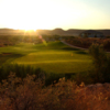 A sunny view of a green at Sunbrook Golf Club
