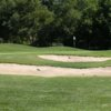 A view of the 12th hole protected by a collection of bunkers at Painted Hills Golf Club