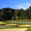 A view of a green protected by bunkers at Mystic Golf Club