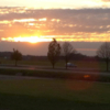 A sunset view of the driving range at Prairie Trace Golf Course
