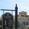 A view of the 1st tee sign and the clubhouse in background at Alhambra Golf Course
