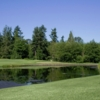 A view over the water of the 16th hole at Loomis Trail Golf Club