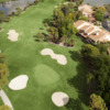 Aerial view of hole #16 surrounded by bunkers at Bobcat from Forest Country Club