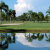 A view over the water of a green at Fort Myers Country Club