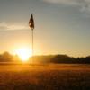 Sunrise over a green at Woodside Greens Golf Club