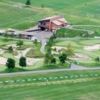 Aerial view of the clubhouse and driving range tees at Victory Links Golf Course