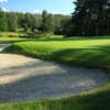 A view of a green protected by a bunker at Golf Resort Karlovy Vary