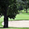 A view of a green protected by sand traps at Santo Domingo Country Club