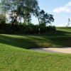 A view of a green protected by a tricky sand trap at Madison Club
