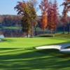 A fall view of a green protected by bunkers at Kinloch Golf Club