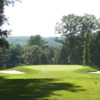 A view of a green flanked by bunkers at Windham Club
