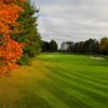 An autumn view of a fairway and green from Fountains at Garland Golf Course