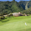 View of a green with the clubhouse in the back at King Kamehameha Golf Club