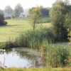 A view over the water of a fairway at Golf & Country Club de Wijnvelden