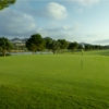A view of a green with water in background at North Course from La Manga Club Golf Resort