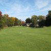 A view of  a fairway protected by fall coloured trees at McCann Memorial Golf Course
