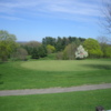 A spring view of a green at College Hill Golf Course