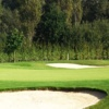 A view of the 8th green protected by sand traps at Golf Club De Kluizen