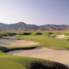 A view of a green surrounded by tricky sand traps from Dayton Valley Golf Club (Arnold Palmer Design)