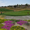 A look at Highland Falls Golf Club's 10th green, with the fairway in the background. The green is protected from the back by a large bunker -- and by beautiful flowers.
