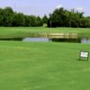 A view over the water of green #4 at Pecan Trails Golf Course