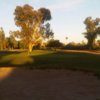 A sunset view of a hole at Shalimar Golf Club