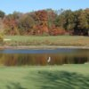 A fall view of a hole with water coming into play at Whittaker Woods Golf Course