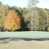 A fall view of a green at Lambert Acres Golf Club