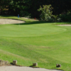 A view of a green protected by tricky sand traps at Chevy Chase Country Club