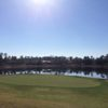 A sunny day view of a green with water in background at DeBary Golf and Country Club