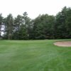 A view of green #1 flanked by sand traps at Ellinwood Country Club