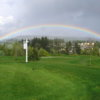 A view of a ainbow over hole #1 at Chehalem Glenn Golf Club