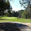 A view of a green protected by tricky bunkers at El Cariso Golf Course